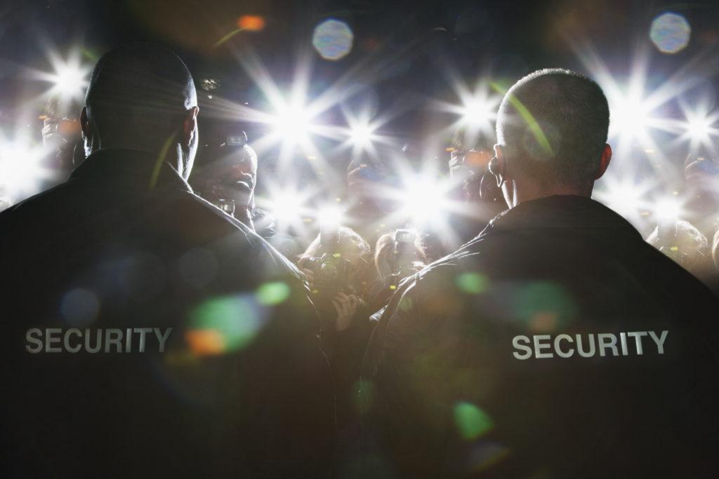 Security Guards blocking paparazzi